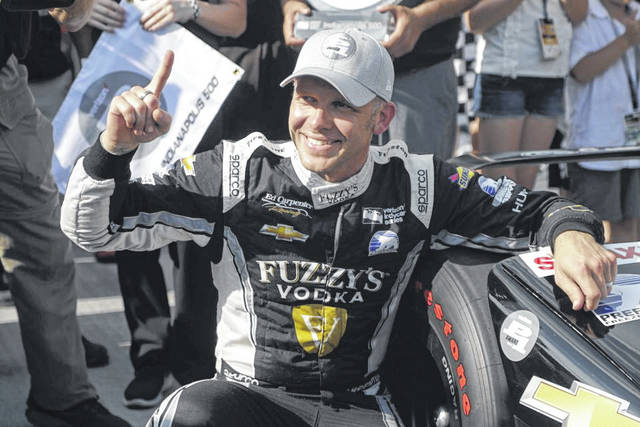 Ed Carpenter celebrates after winning the pole during qualifications for the IndyCar Indianapolis 500 auto race at the Indianapolis Motor Speedway on Sunday.