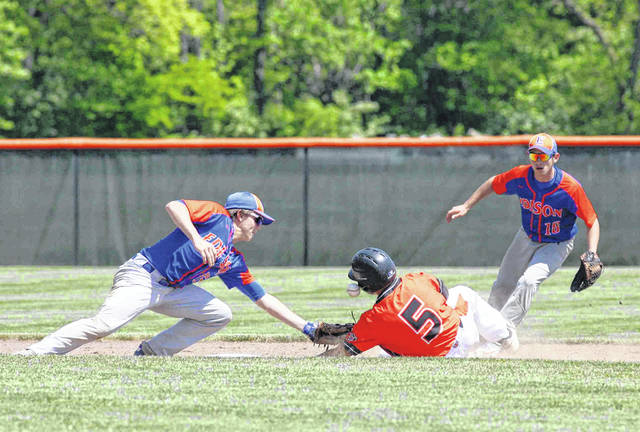Coldwater's Joey Welsch slides safely into second against Milan Edison's Cooper McIntyre during a Thursday Division III regional semifinal at Elida.