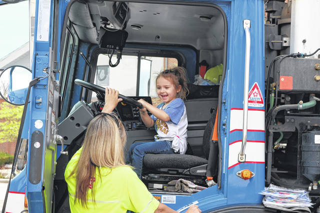 Sofia Lozzio, 4, enjoys sitting behind the wheel of a garbage truck.
