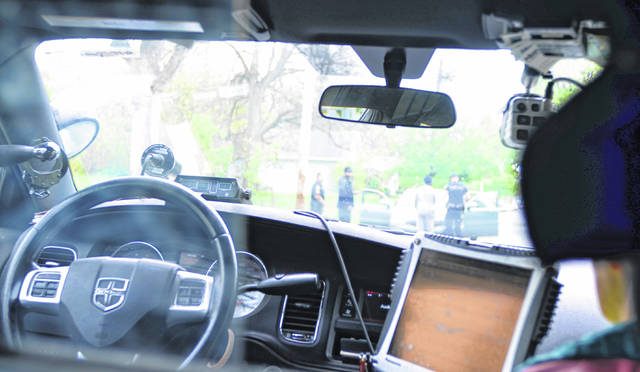 The view from the inside of a police cruiser.