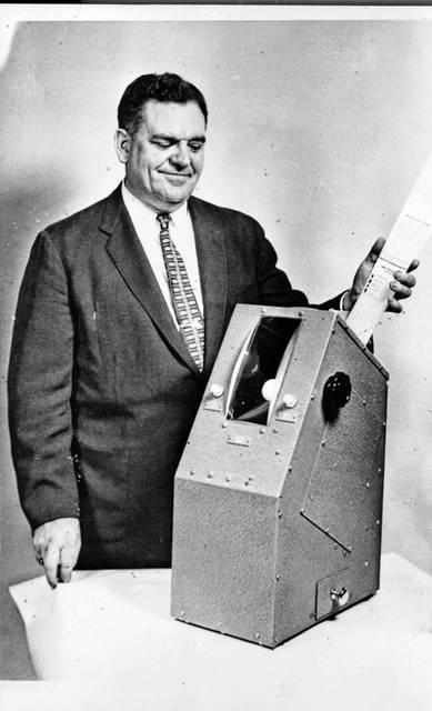 This 1960 Lima Citizen photo shows a Coyle machine with its maker. Inventor Martin A. Coyle, of Cincinnati, and his Coyle voting machine, which was produced by Lennox, and used in Lima elections.