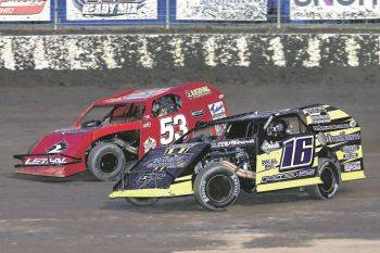 Bobby Stremme (53) and Jeff Koz race for the lead during Friday night racing at Limaland Motorsports Park. Mike Campbell photo