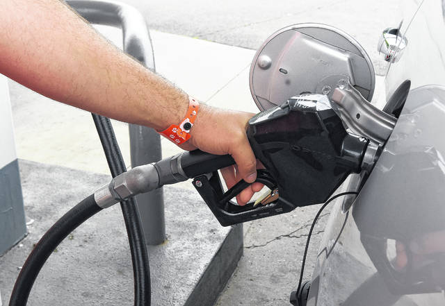 An area resident pumps gas at a station on Eastown Road in Lima.