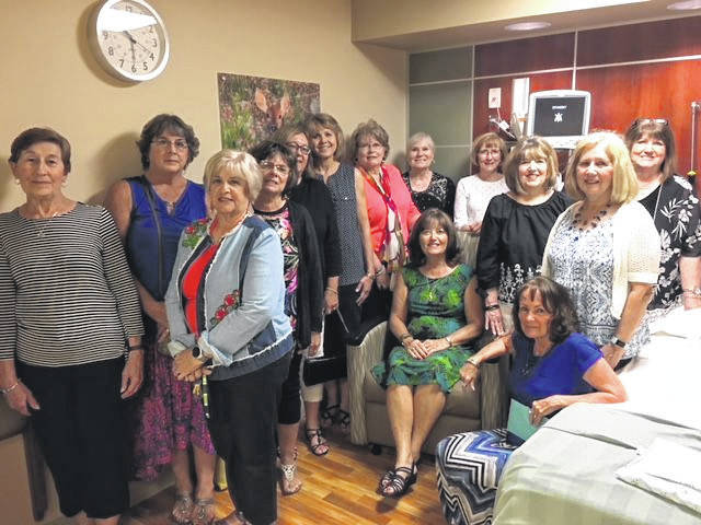 Members of the Guiding Mothers of St. Marys Ohio Child Conservation League are pictured with new glider chairs the group donated for the ambulatory surgery center at Joint Township District Hospital.