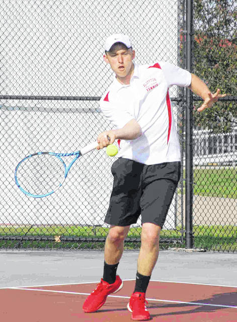 Bluffton's Justin Haggard hits a return during Saturday's Division II sectional singles competition at the University of Northwestern Ohio. Jose Nogueras | The Lima News