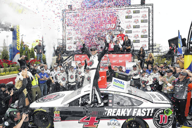 Kevin Harvick celebrates in Victory Lane after he won the NASCAR Cup Series auto race, the Monster Energy 400 Drive for Autism on Sunday at Dover International Speedway in Dover, Del.	He dominated, leading 201 of 400 laps.