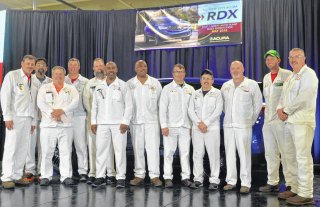 Anna Honda's Anna Engine Plant employees, Jim Mankin, Manish Surana, Rick Bordner, Ron Raterman, Stuart Nadolay, Marvin Beverly, Shelby Basil, Bret Blymyer, Mark Maus, Dan Elliott, John MeinerDing and Doug Esser stand in front of new 2019 Acura RDX luxury SUV during celebration at East Liberty Honda Auto Plant, Tuesday.