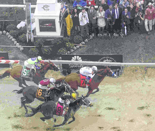 Justify with Mike Smith atop wins the 143rd Preakness Stakes horse race at Pimlico race track, Saturday, May 19, 2018, in Baltimore. Bravazo with Luis Saez aboard (8) wins second with Tenfold with Ricardo Santana Jr. atop (6) places. (AP Photo/Nick Wass)