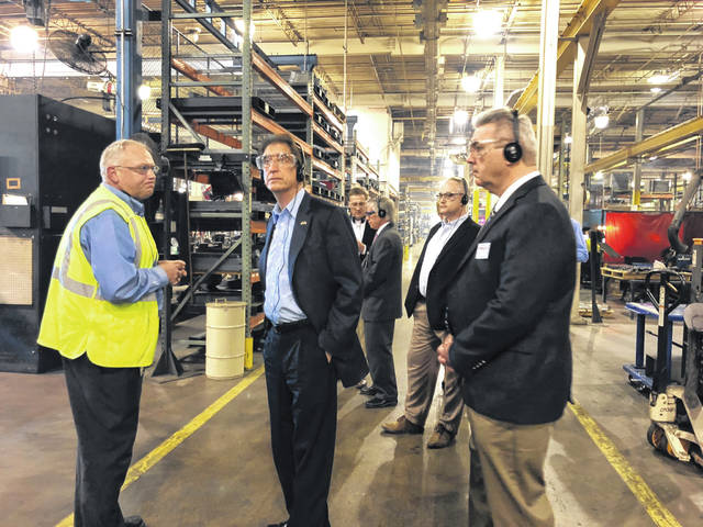 Republican Senate Candidate Jim Renacci (second from left) tours Crown's factory floor in Celina.