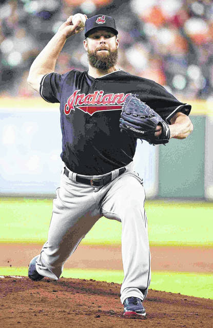 Cleveland Indians starting pitcher Corey Kluber delivers during the first inning of the team's baseball game against the Houston Astros, Saturday, May 19, 2018, in Houston. (AP Photo/Eric Christian Smith)