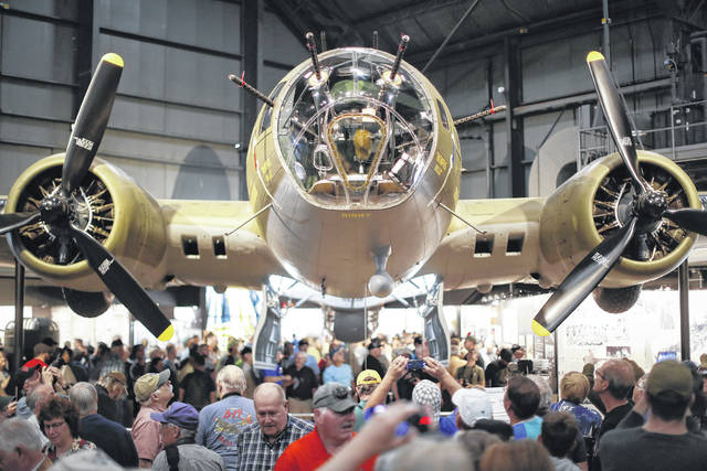 "Visitors gather beside the Memphis Belle, a Boeing B-17 ""Flying Fortress,"" on its first day of public exhibition at the National Museum of the U.S. Air Force, Thursday, May 17, 2018, in Dayton, Ohio. The B-17 ""Flying Fortress"" will anchor an extensive exhibit in the museum's World War II gallery, paying tribute to the thousands of men who served on B-17s on daylight bombing missions over Nazi-occupied Europe. The plane was celebrated for being the first B-17 to survive 25 missions and return to the U.S."