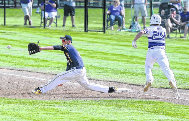 Ottawa-Glandorf's Nathan Arrington receives the throw to force out Fort Recovery's Will Homan at first base during a Thursday Division III district semifinal at Ed Sandy Field in Elida.