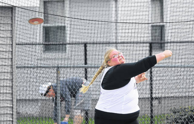 Leipsic's Grace Rigel competes in the discus throw during Friday night's Putnam County League Meet in Columbus Grove.  Richard Parrish | The Lima News