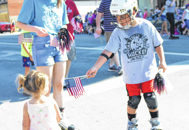 The Lima Exchange Club passed out small flags to many of the children standing on the sidelines during Lima's 2018 Memorial Day Parade.