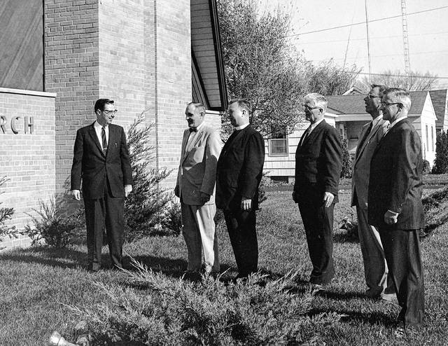 Church officials gathered for a photo in about 1961. Pastor Paul Single is on the left.