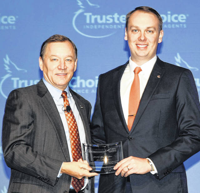 Photo submitted Evan Purmort (right), vice president of the Northeast Regional Office Manager for Central Insurance Companies, accepts the Best Practices Award of Excellence from Robert Rusbuldt, president and CEO of the Independent Insurance Agents and Brokers of America.