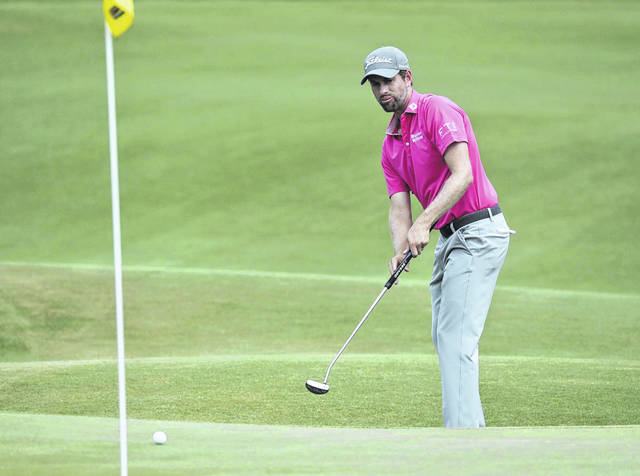Webb Simpson watches his putt on the eighth green, during the final round of the The Players Championship golf tournament Sunday in Ponte Vedra Beach, Fla.