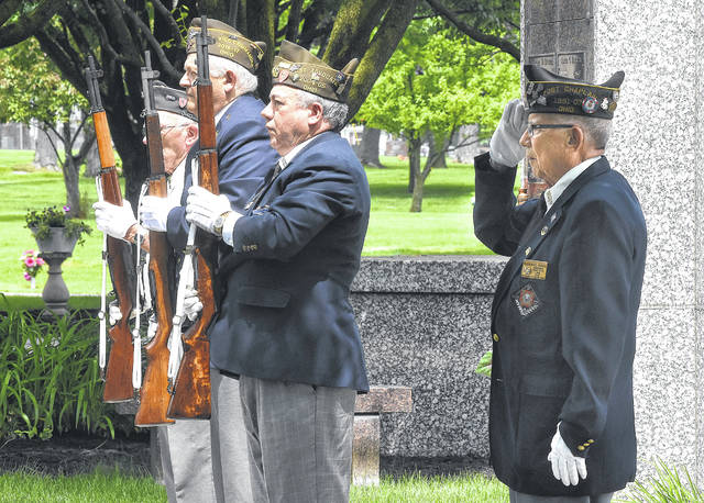 Members of Lima VFW Post 1275 firing squad, left to right, Roger Lamb, Butch Brewer, Ray Magnus and Dick Coon, stand at attention during a burial ceremony of World War II veteran William Spacer of Lima at Gethsemani Cemetery.