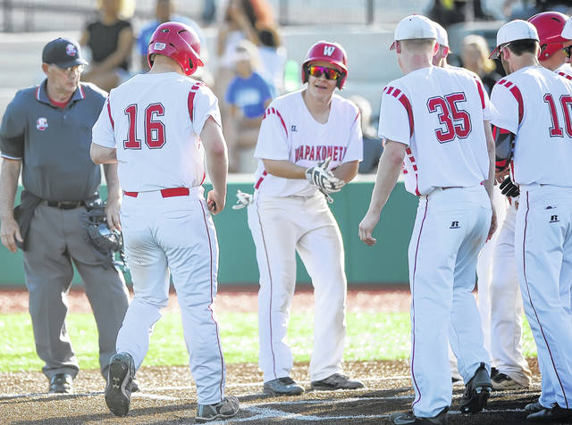 Wapakoneta's Manny Vorhees (16) is met at the home plate after hitting a home run Tuesday at Defiance.