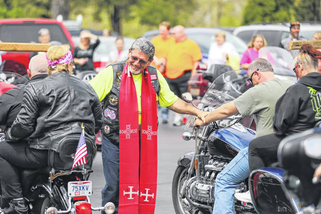 Chaplain of the Lima Fire Department, Larry Inskeep, says a short prayer for each motorcyclist during a past Blessing of the Bikes at Shawnee United Methodist Church.