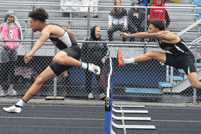 Elida's Xavier Gilkey leads teammate KeShawn Spivey in the 110 hurdles during Friday night's Division II district meet at at  Fred Brown Stadium in Defiance. Dean Brown | The Lima News