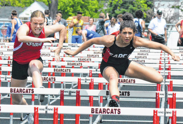 Spencerville's Nelayla Burden, right, and Columbus Grove's Carlee McCluer, here running in the 100 meter hurdles during Saturday's Division III district at Charles D. Moeller track in Spencerville, are among the top hurdlers in the area and are scheduled to renew their rivalry this week at regionals.