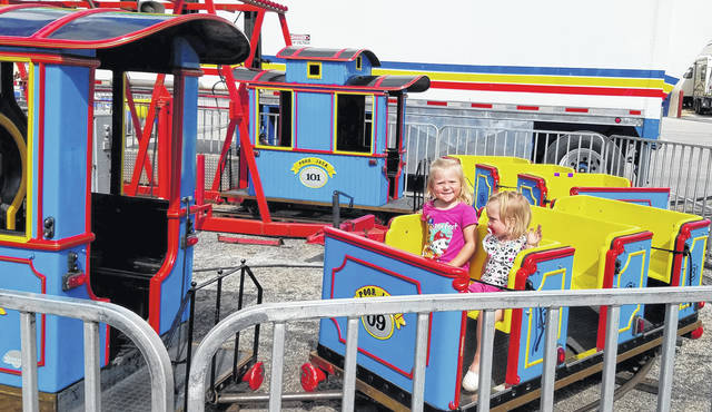 Kierstyn Garber, left, and Kylie Garber enjoy a trip around the tracks at a past Allen County Fair.
