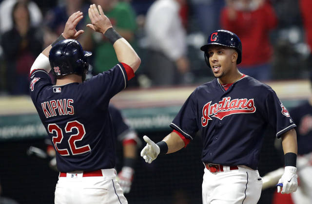 Cleveland Indians' Jason Kipnis congratulates Michael Brantley, right, after Brantley hit a grand slam during the ninth inning of Tuesday night's home game against the Texas Rangers. (AP Photo/Tony Dejak)