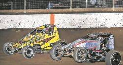 Landon Simon (24) battles Matt Westfall during Friday night racing at Limaland Motorsports Park. Mike Campbell photo