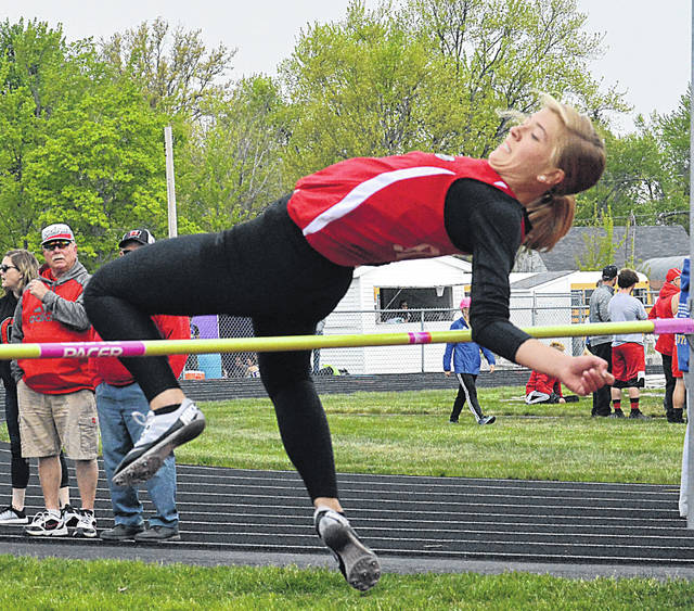 Columbus Grove Bulldog Kayla Reynolds clears the bar Saturday during in the Northwest Conference Meet high jump competition in Spencerville. Dean Brown   The Lima News