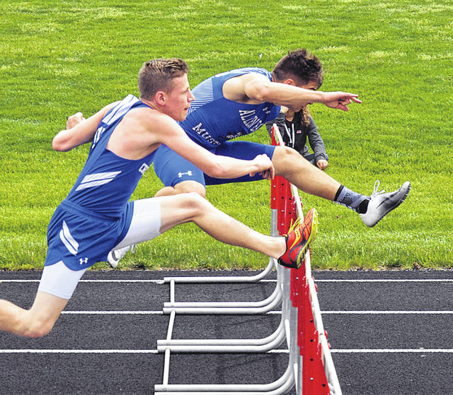 Allen East's Kyle Nickles, right, and Crestview's Tyler White compete in the 110 meter hurdles Saturday during the Northwest Conference Meet in Spencerville. Dean Brown   The Lima News