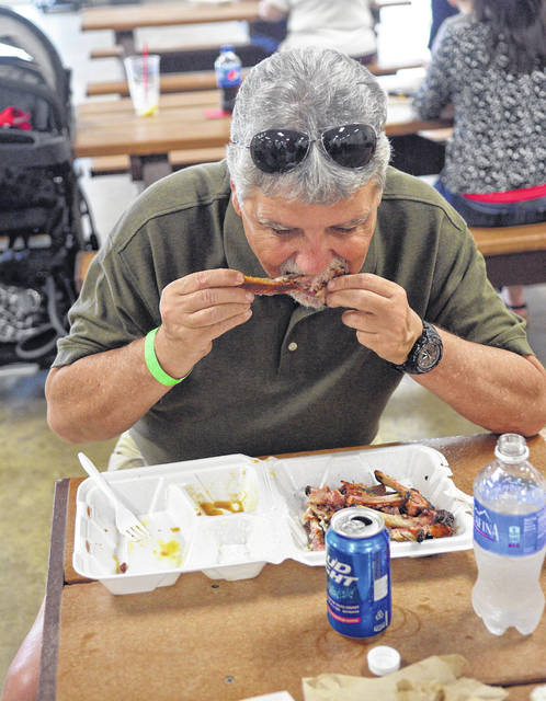 Brent Heppeard, of Van Wert, devours some ribs at a past event.