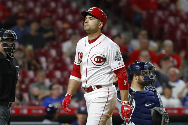 Cincinnati Reds' Joey Votto reacts after striking out looking against Milwaukee Brewers relief pitcher Jeremy Jeffress during the eighth inning of Tuesday night's game in Cincinnati. (AP Photo/John Minchillo)