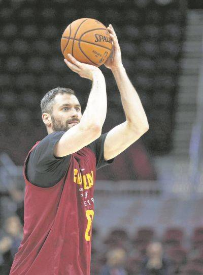 The Cavaliers' Kevin Love practices Tuesday at Quicken Loans Arena in Cleveland.