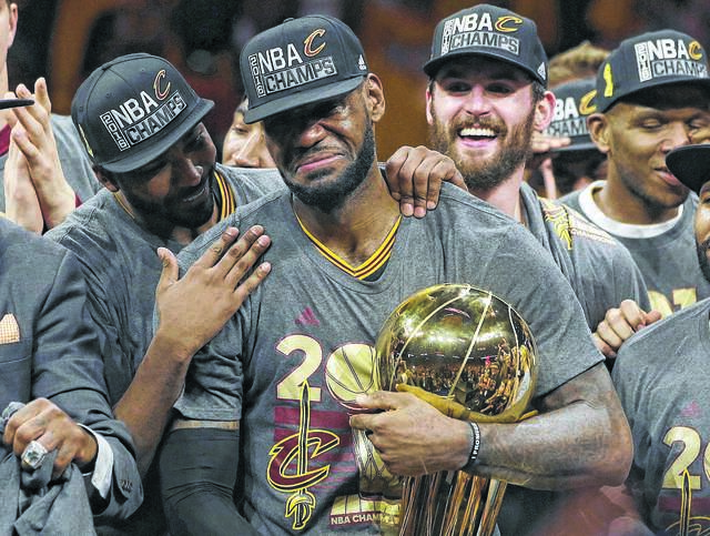 LeBron James, center, and the Cleveland Cavaliers brought Cleveland its first NBA title in 2016 and its first major professional sports championship in 52 years. Will his attachment to Northeast Ohio play a role in his decision where to play next season?