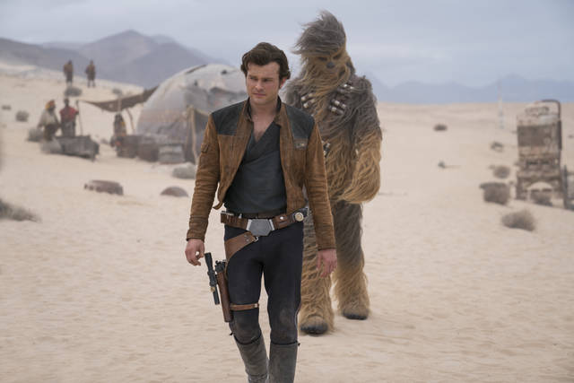 "FILE - This undated file image released by Lucasfilm shows Alden Ehrenreich and Joonas Suotamo in a scene from ""Solo: A Star Wars Story."" In a box-office blip that echoed through the multiplexes, ""Solo: A Star Wars Story"" didn't fare well over the Memorial Day weekend, amassing an estimated $103 million in ticket sales from Thursday night to Monday, May 28, 2018. (Jonathan Olley/Lucasfilm via AP, File)"