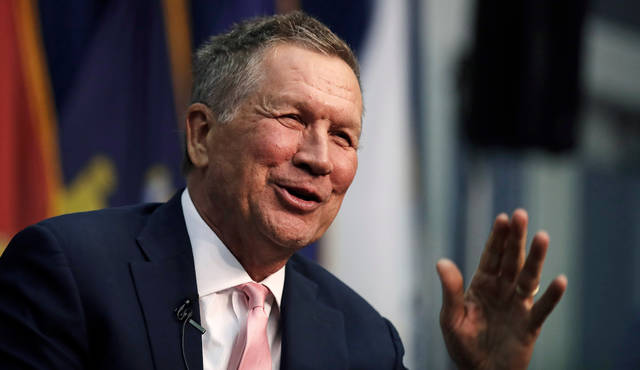 FILE - In this April 3, 2018, file photo, Ohio Gov. John Kasich, a former 2016 Republican Presidential hopeful, smiles as he addresses a gathering during a visit to New England College in Henniker, N.H. Many people responding to proposed rules regulating painkillers for patients suffering chronic pain say those patients should automatically be given prescriptions for anti-overdose drugs. Comments on the rules proposed by Kasich say having physicians simply offer the anti-overdose drugs to patients doesn't go far enough. (AP Photo/Charles Krupa, File)