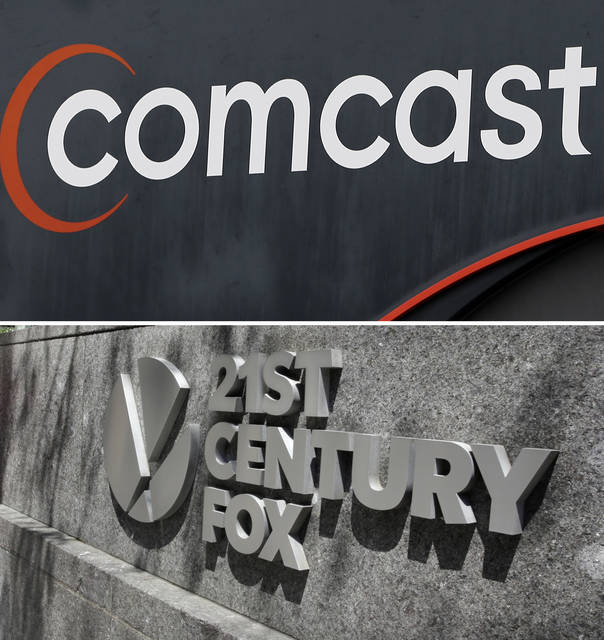 This combo of file photos shows the 21st Century Fox sign outside of the News Corporation headquarters building in 2017 in New York, bottom, and a Comcast sign in 2017, in Hialeah, Fla. Comcast is making a $65 billion bid for Fox's entertainment businesses, setting up a battle with Disney to become the next mega-media company.