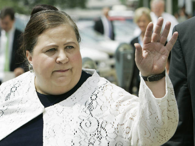 FILE - In this July 11, 2007 file photo, former Alabama Secretary of State Nancy Worley waves goodbye to a friend after leaving the Montgomery County Courthouse for her trial on charges of violating election laws in Montgomery, Ala. On Thursday, June 14, 2018, The Associated Press has found that stories circulating on the internet that Worley, the head of the Alabama Democratic Party, has recently been arrested are untrue.