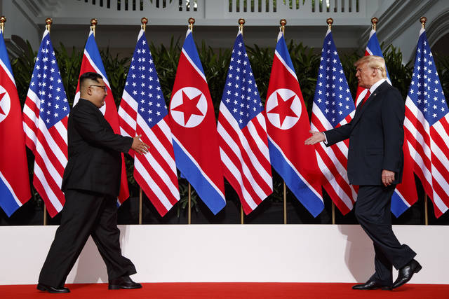 In this June 12 photo, President Donald Trump meets with North Korean leader Kim Jong Un on Sentosa Island in Singapore. Trump credits his accord with North Korea's Kim Jong Un with saving tens of millions from nuclear war. Now he just has to get everyone else on board. Frustrated with lukewarm backing from congressional Republicans, criticism from Democratic opponents, and skepticism from allies and the media, President Donald Trump made an extraordinary stop on the North Lawn of the White House Friday to promote the nuclear deal that critics have decried as a vague and lacking in clear objectives.