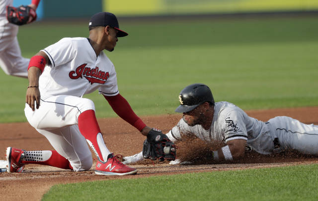 Cleveland Indians' Francisco Lindor, left, tags out Chicago White Sox's Yoan Moncada after Moncada tried to steal second base in the first inning of a baseball game, Monday.