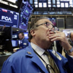 Dow posts 6th loss in row on trade spat; small cos. rally