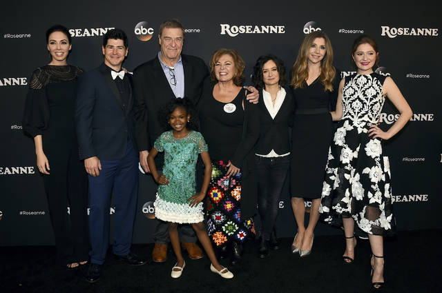 """In this March photo, from left, Whitney Cummings, Michael Fishman, John Goodman, Jayden Rey, Roseanne Barr, Sara Gilbert, Sarah Chalke and Emma Kenney arrive at the Los Angeles premiere of """"Roseanne"""" in Burbank, Calif. ABC, which canceled its """"Roseanne"""" revival over its star's racist tweet, said Thursday it will air a Conner family sitcom minus Roseanne Barr this fall."""