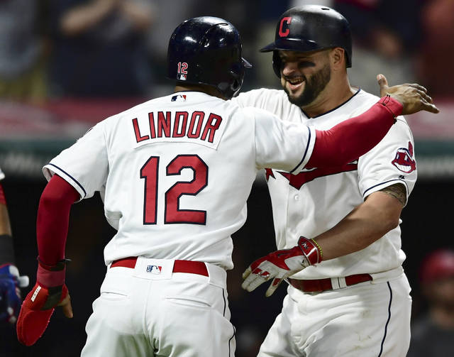 Cleveland Indians' Yonder Alonso, right, is congratulated by Francisco Lindor after hitting a grand slam off Detroit Tigers relief pitcher Johnny Barbato during the seventh inning of a baseball game Friday.