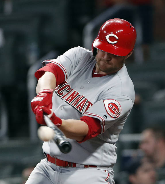 Cincinnati Reds right fielder Scott Schebler (43) connects on a solo-home run in the fifth Inning of a baseball game against the Atlanta Braves Monday in Atlanta.
