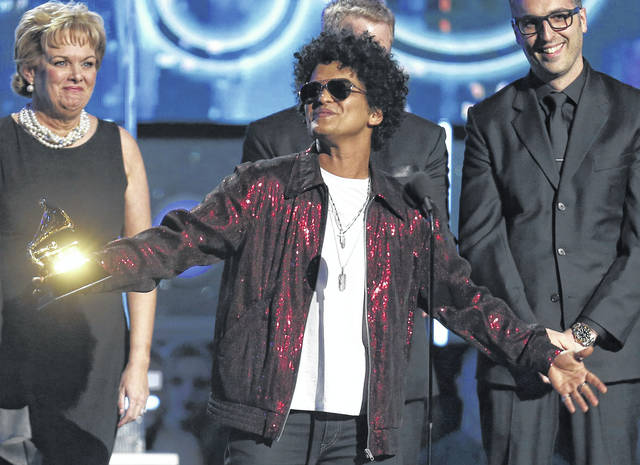 "Bruno Mars accepts the award for record of the year for ""24K Magic"" on Jan. 28 at the 60th annual Grammy Awards in New York. The Grammy Awards are extending the number of nominees in its top categories from five to eight."