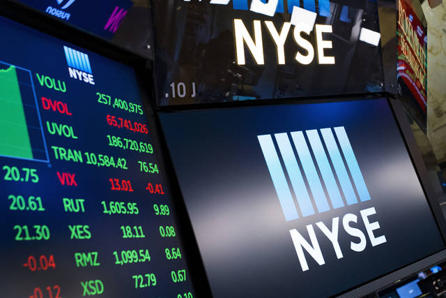 FILE- In this May 10, 2018, file photo, stock screens are shown at the New York Stock Exchange. The U.S. stock market opens at 9:30 a.m. EDT on Wednesday, June 27. (AP Photo/Mark Lennihan, File)