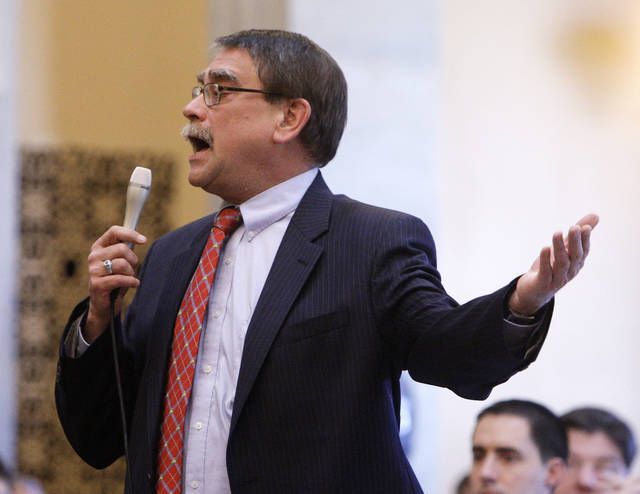 "FILE – In this March 2, 2011, file photo, Ohio state Sen. Bill Seitz discusses a bill about collective bargaining rights for public employees, during a floor debate in Columbus, Ohio. A law firm where Seitz worked for 36 years, retained by the state attorney general's office to independently investigate a complaint by a female House employee, concluded in April 2018 that the Republican lawmaker from Cincinnati had not violated the House's anti-harassment policy in remarks at an off-site party the employee claimed ""glorified a sexual harasser and minimized his victim and all victims of sexual harassment."" (AP Photo/Jay LaPrete, File)"