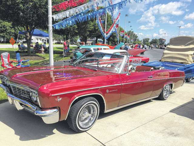 Jerry Lynch Of Wapakoneta Enjoys Working On Old Cars Including His 1966 Chevy