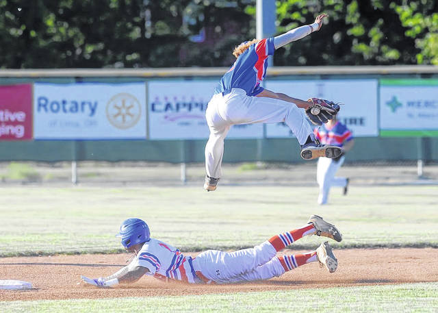 Justin Wiley slides in safely for a steal at second base underneath a leaping Tyler Simon during Monday's Lima Locos scrimmage at Simmons Field.